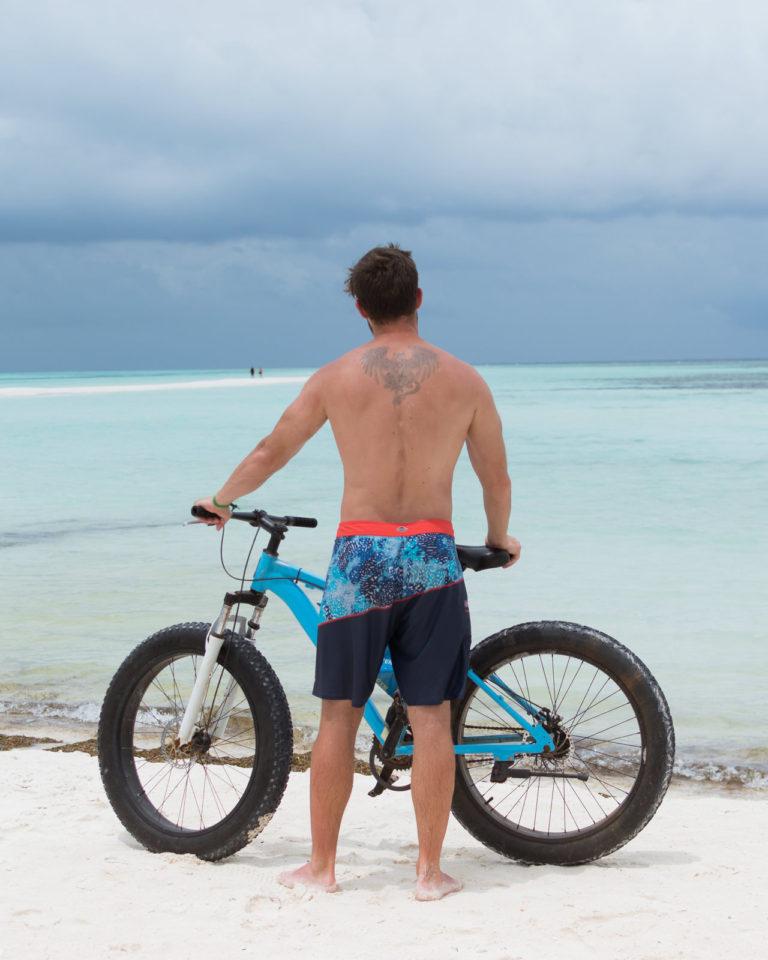 Fat Bike on beach in Maldives and standing biker