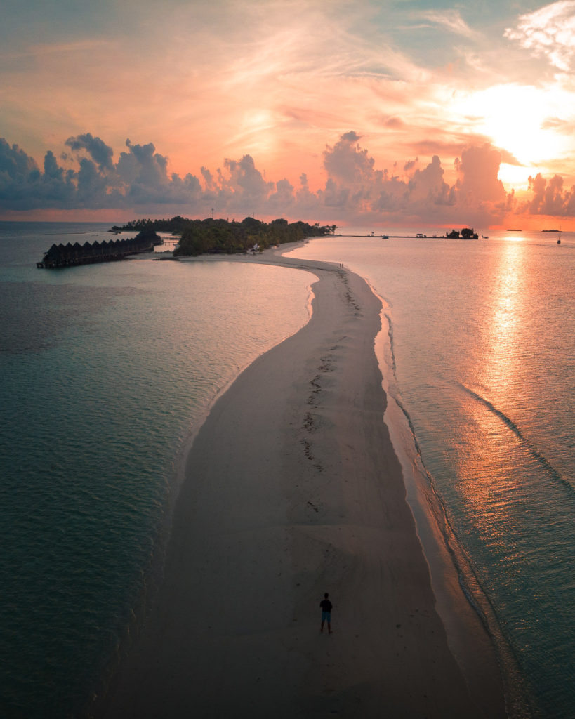 Beach on Maldives during sunset in the Arabian Sea