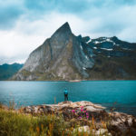 Breathtaking landscape photography of Knight On Trip standing on a cliff near Hamnøy Village