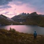 Majestic Moskenes mountains and lake during a sunset