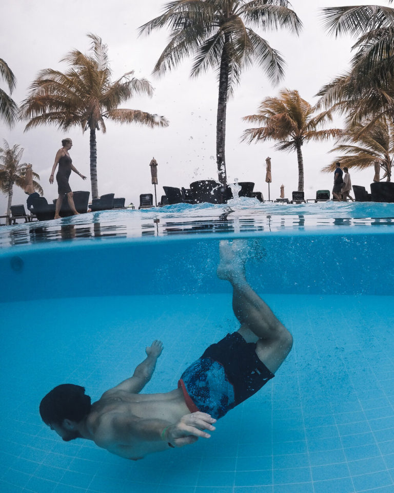 Swimming in pool at Hotel Resort in Maldives during storm