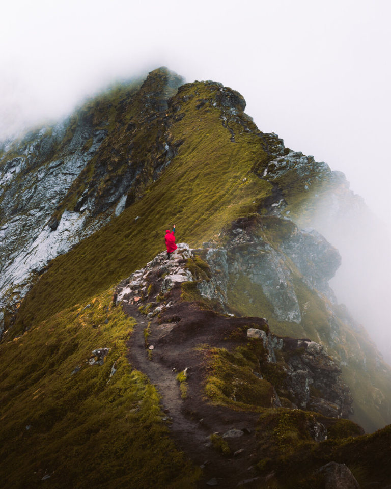 Photography of Jan Klíma hiking in Reinebringen mountain that is covered in fog