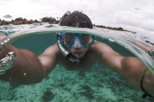 Half-in water half-out of water selfie during diving in sea