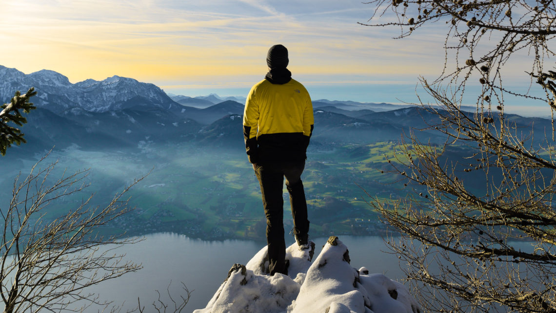 Knight On Trip standing on the top of Traunstein mountain during sunset