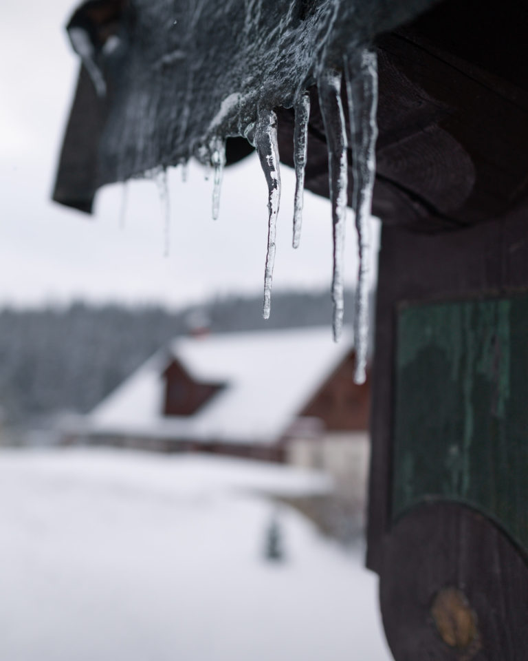 Icicles and snowy landscape view in Jizera Mountains