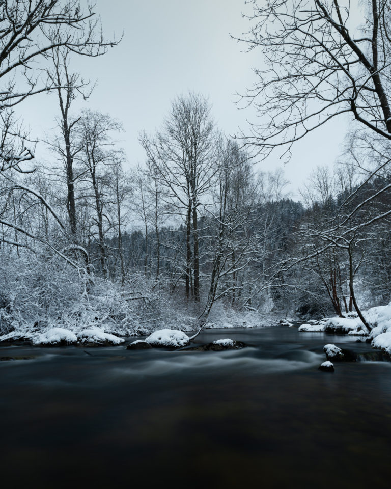 River and snow landscape view in Jizera Mountains