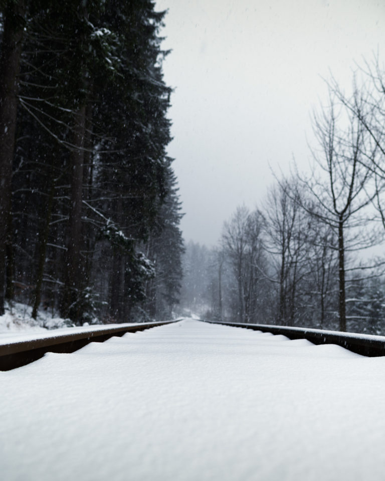 Snowflakes and snowy train rails view in Jizera Mountains