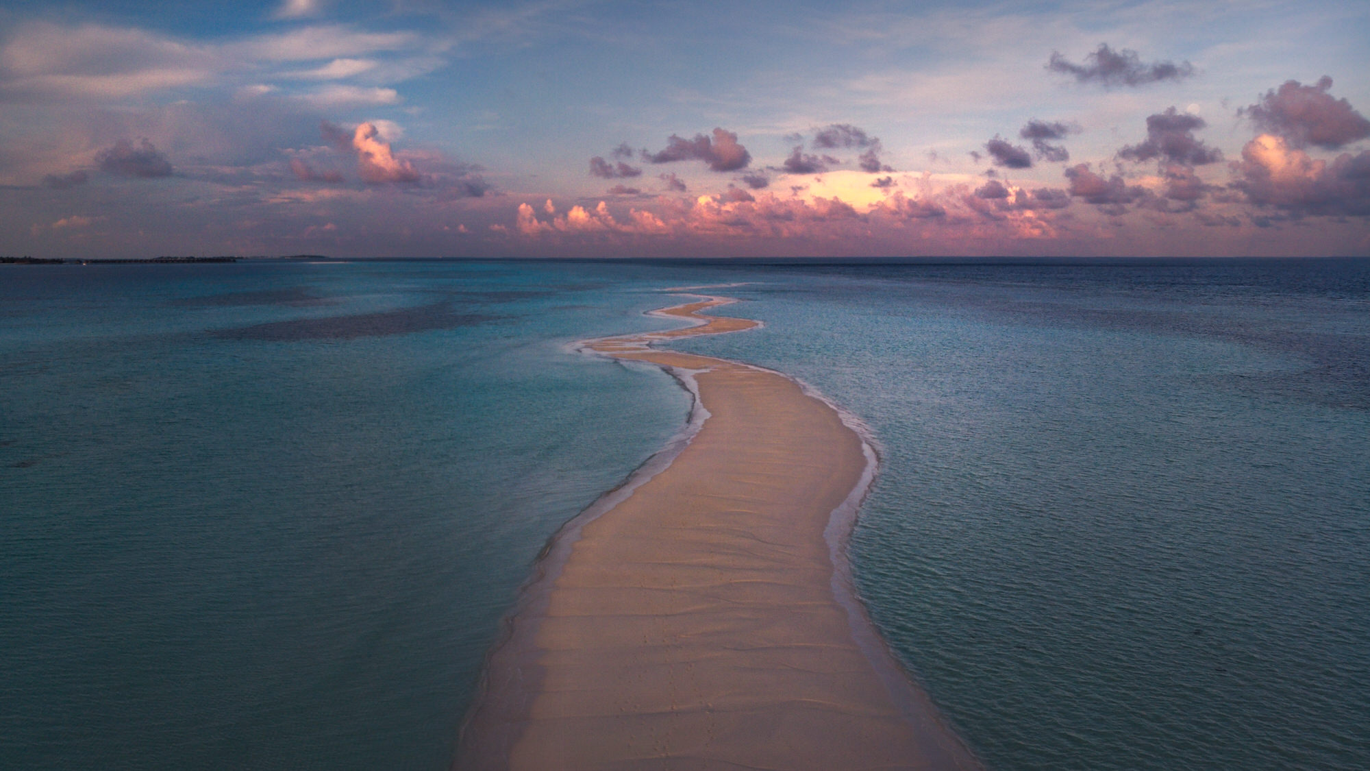 Maldives - Long Beach at Sunrise - wide drone view