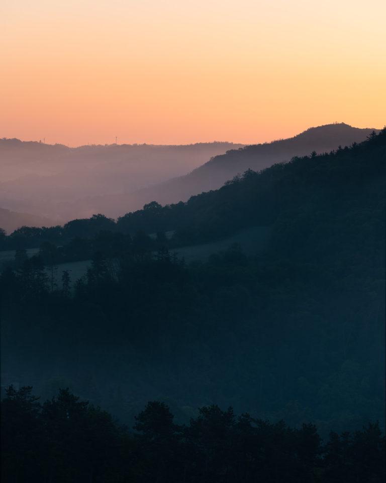 Sunrise view with foggy landscape in Svaty Jan pod Skalou